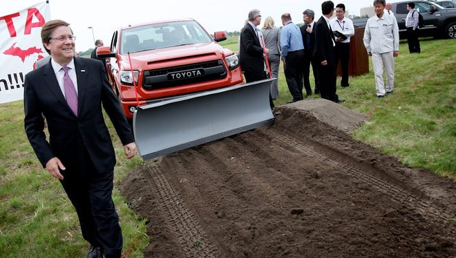 Toyota North America's CEO Jim Lentz, left, walks to speak to the media after the ceremony. Toyota officially broke ground today on the expansion of the Toyota Technical Center (TTC) in York Township, MI with a push of a plow by a 2015 Toyota  Tundra TRD Pro on Thursday, June 11, 2015. The ceremony included remarks by Toyota North America CEO Jim Lentz and community donation to the Fire Departments.