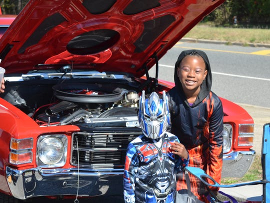Kids attend a trunk-or-treat car show in Millville.