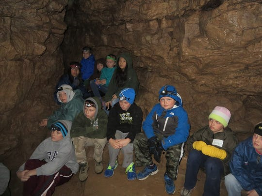 The fourth-grade class from Fox Valley Christian Academy gathered in the Ledge View Caves to learn about Wisconsin geology and cave formation. They also received a lesson in fossil formation, and had the opportunity to hike to the quarry to dig for and identify the fossils they learned about.