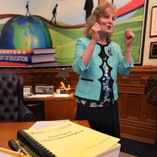 The 1,000-page amended federal waiver sits on the desk of Indiana Superintendent of Public Education Glenda Ritz during a news conference Aug. 28, 2014, in Indianapolis.