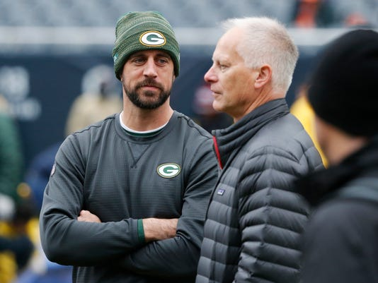Green Bay Packers' Aaron Rodgers, talk to ESPN's Kenny Mayne before an NFL football game against the Chicago Bears, Sunday, Nov. 12, 2017, in Chicago. (AP Photo/Charles Rex Arbogast)