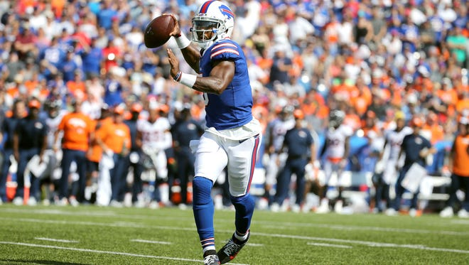 Bills quarterback Tyrod Taylor throws while rolling outside of the pocket against Denver.