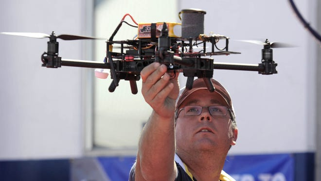 Rob Dunbar flies his drone in a net-enclosed area in the Drone Zone during the Reno Air Races on Sept. 12, 2014.