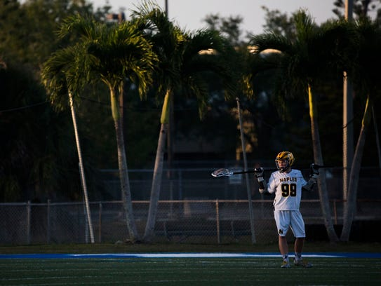 Naples' Blake Novak looks up at the scoreboard after