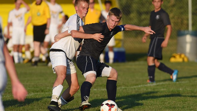 Tri-Valley's Noah Alfman, left, and Morgan's Jordan Work battle for the ball. Work signed his letter of intent to play soccer for Ohio Valley on Thursday.