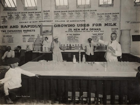 Men and women work in the University of Wisconsin dairy