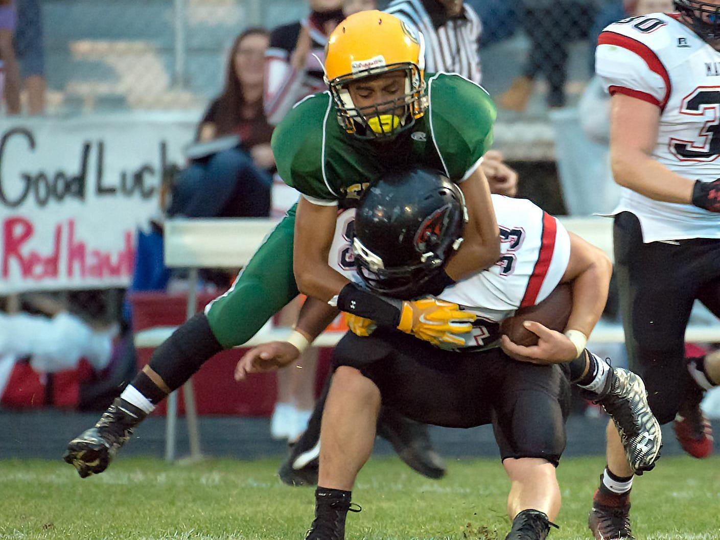 Panthers Domonick Gibson (12) has an open field tackle on Marshall's RB Christ Upright (33) Friday night.