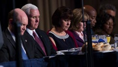 Vice President Mike Pence and his wife Karen pray during