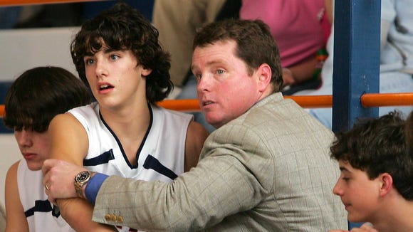 In this 2007 photo, Tri-County Academy head coach Rod Delaney urges Cole McDaniel into the game during against Heidelberg Academy.