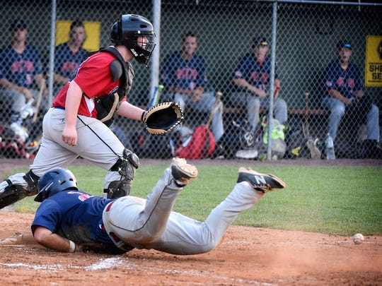 Campbelltown catcher Jacob Roe can't connect with a throw to home and a runner from Pleasureville scores during Tuesday night's matchup at Earl Wenger Field.