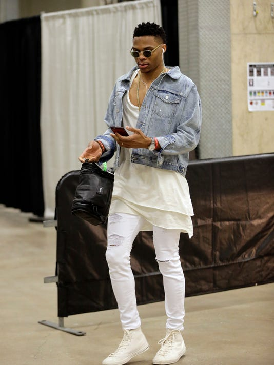 FILE - In this May 10, 2016, file photo, Oklahoma City Thunder guard Russell Westbrook arrives for Game 5 of a second-round NBA basketball playoff series in San Antonio. The five-time All-Star passes his time designing clothes, perched on the front row for shows during New York Fashion Week or talking style and tennis with Vogue magazine editor-in-chief Anna Wintour.  (AP Photo/Eric Gay, File)