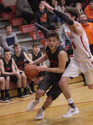 Gibsonburg's Josh Ernsthausen drives to the basket against SJCC's Spencer Harrison.