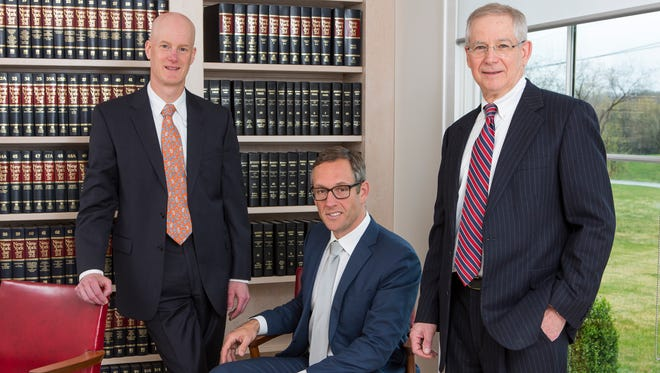 From left: David R. Wise, Joshua E. Mackey and Robert R. Butts of the law firm Mackey, Butts & Wise, LLP