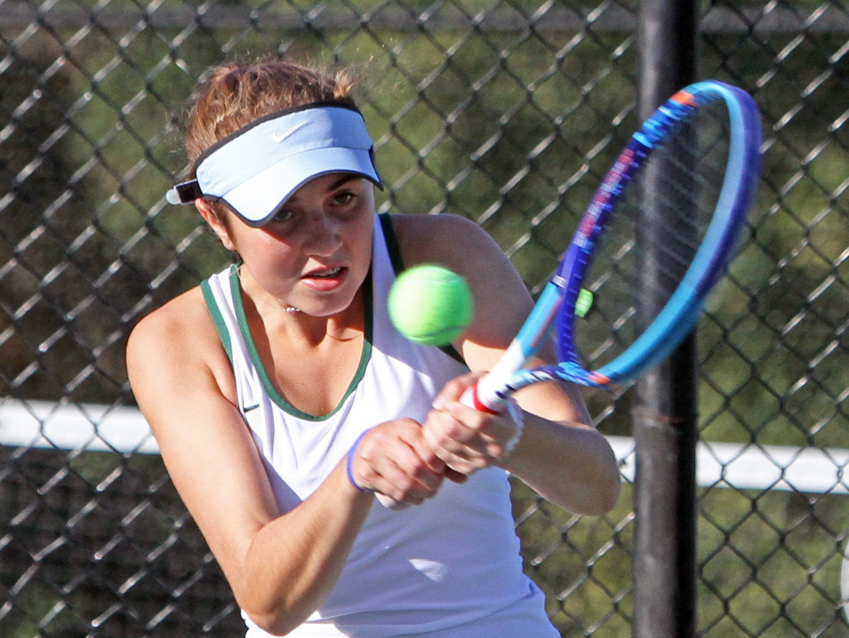 Top seeded Caitlyn Ferrante of Yorktown returns a shot to Maxine Zaretsky of Briarcliff during the Section 1 Girls' Tennis Singles Championship Tournament at Harrison High School Oct. 20, 2015.