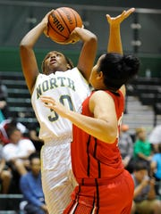 North's Frednesha Adams (30) shoots past Harrison's  Kyla Reid (40) during their game at North High School in Evansville, Tuesday, Nov, 1, 2016. North beat Harrison 82-39.