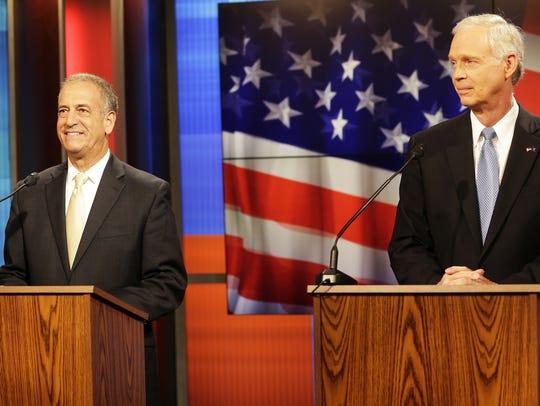 Wisconsin Republican Sen. Ron Johnson, right, and his