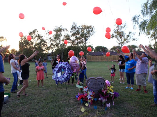 Balloons are released during a celebration of Eguia's life Thursday, April 14, 2017, which would have been her 29th birthday, at Seaside Memorial Park. Nearly a year ago, Eguia was beaten to death by her boyfriend in an abandoned shed. She was seven months pregnant with a girl she planned to name Juliette Amberlynn. The balloons carried an invitation to her brother's, Larry Hernandez, wedding. There will be an empty seat for her and the baby at the wedding.