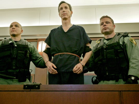 Warren Jeffs stands flanked by two Las Vegas Police