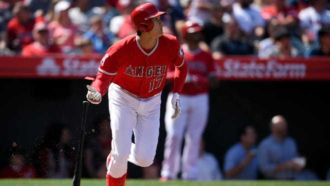 Shohei Ohtani looks up after hitting a two-run home run in the fifth inning.