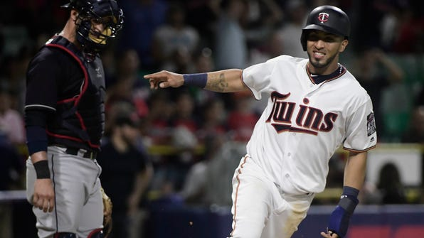 Minnesota Twins' Eddie Rosario scores in the 16h inning to give the Twins a 2-1 win over the Cleveland Indians in a baseball game at Hiram Bithorn Stadium in San Juan, Puerto Rico, early Thursday, April 19, 2018. (AP Photo/Carlos Giusti)
