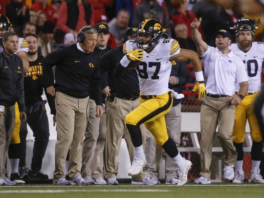 Noah Fant (87) races up the right sideline for a 68-yard touchdown at Nebraska in what turned out to be a 56-14 Hawkeye win inside Memorial Stadium.
