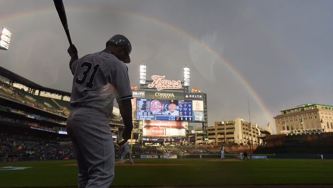 Yankees' Gregorio Petit is on deck in the second inning with a rainbow overhead. The Tigers have continued to play with optimism in the late innings this season.