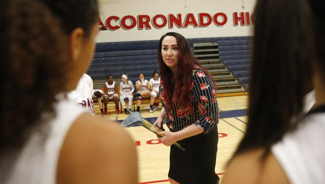 Coronado High head coach Jamie Fellows talks with her team before playing against Higley High in Scottsdale, Ariz. January 29, 2018.