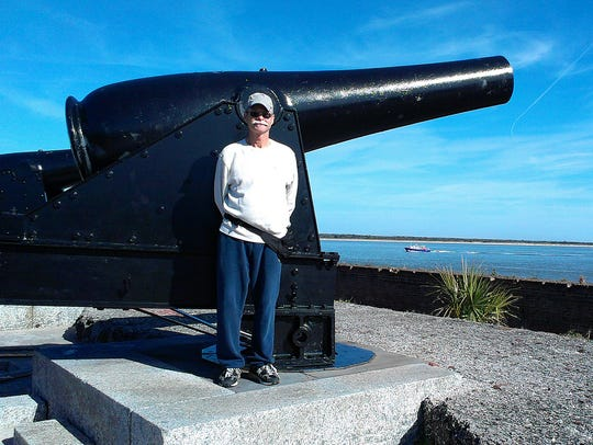 My husband checks out the cannon inside Fort Clinch.