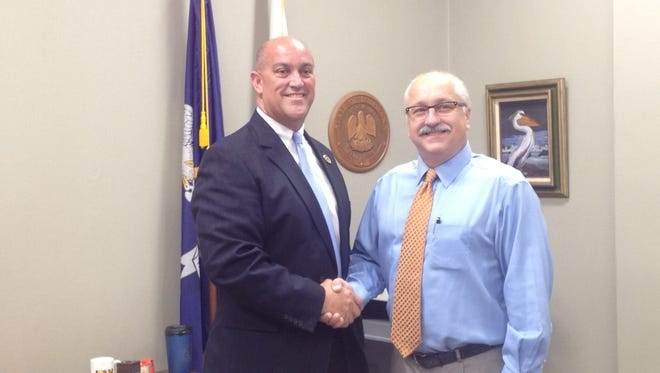 Sheriff candidate Chad Leger shakes hands with Lafayette Parish Clerk of Court Louis Perret.