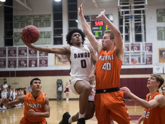 Bearden's Ques Glover attempts to score while defended