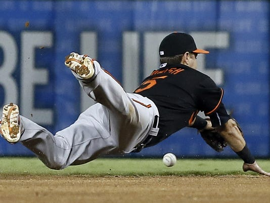 Baltimore Orioles shortstop Paul Janish is unable to reach a single by Texas Rangers' Adrian Beltre in the fourth inning of a baseball game Friday, Aug. 28, 2015, in Arlington, Texas. (AP Photo/Tony Gutierrez)