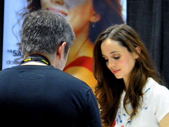 "Actress Eliza Dushku (""Buffy the Vampire Slayer"" and ""Dollhouse"") signs an autograph at MegaCon at the Orange County Convention Center."