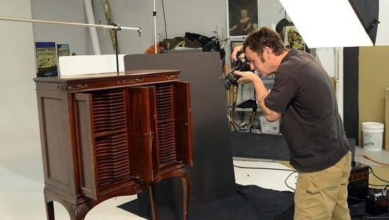 A photographer for the Brunk Auctions at work.