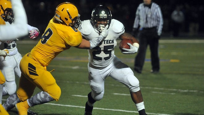 Cass Tech's Mike Weber gets past Fordson's Tarrif Sayed for a run gain on Nov 7, 2014.