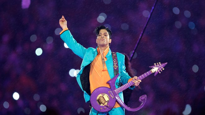 FILE - In this Feb. 4, 2007 file photo, Prince performs during the halftime show at the Super Bowl XLI football game at Dolphin Stadium in Miami. The halftime show has become one of the year's top cultural moments, so anticipated that it is commonly seen by more people than the game itself.  (AP Photo/Chris O'Meara, File)