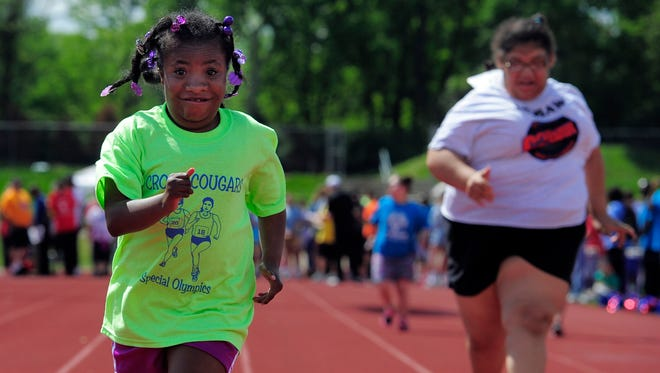 Chloe Smith races down the track during the 50-meter dash at the Special Olympics on Friday, April 22, 2016, at Father Ryan High School.