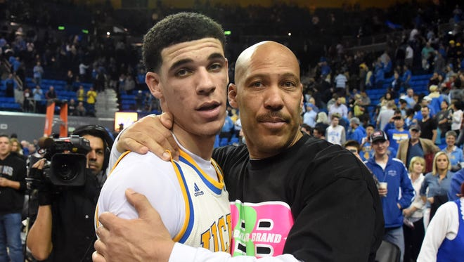 Lavar Ball embraces his son, UCLA Bruins guard Lonzo Ball, after the game against the Washington State Cougars on March 4 in Los Angeles.
