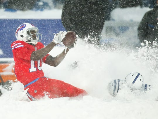 ORCHARD PARK, NY - DECEMBER 10:  Deonte Thompson #10 of the Buffalo Bills catches the ball as Kenny Moore #42 of the Indianapolis Colts attempts to defend him during overtime on December 10, 2017 at New Era Field in Orchard Park, New York.  (Photo by Brett Carlsen/Getty Images)