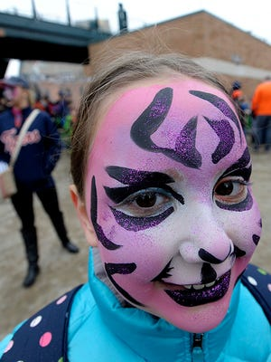 Olivia Regenold, 10, of White Lake, smiles after getting her face painted Saturday at TigerFest at Comerica Park.