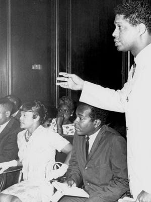 Civil Rights leaders including Dr. Robert B. Hayling (standing) address issues with Florida Governor W. Haydon Burns in Tallahassee.