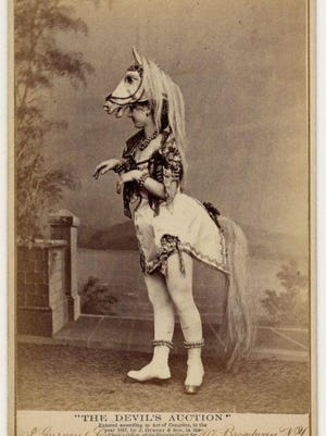 "Dancer from ""The Devil's Auction,"" showing Eliza Blasina wearing a horse head headdress with a short costume, horsetail and rows of round bells or beads on her ankles. Contributed photo"