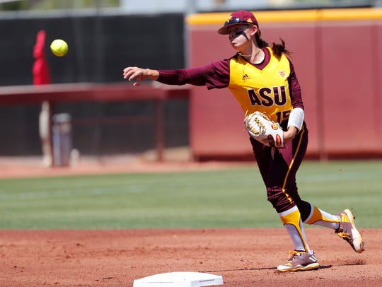 Arizona State shortstop Jade Gortarez (15) throws out