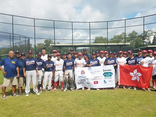 The Guam Senior Little League All-Stars show their sportsmanship with a group photo with the Hong Kong Seniors at the Asia-Pacific Regional Championships July 3 in Manila. Guam beat Hong Kong 15-2 to earn the No. 1 seed entering the playoffs.