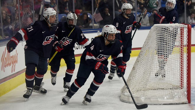 Team USA's Brianna Decker (14) celebrates after scoring a goal in the second period during a December exhibition against Canada.
