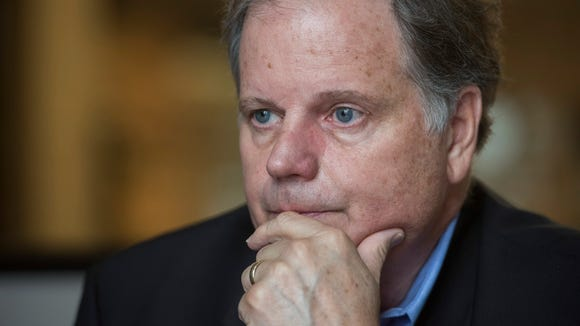 Doug Jones, who is running for U.S. Senate on the Democratic ticket, is interviewed at the Montgomery Advertiser offices in Montgomery, Ala. on Thursday June 29, 2017.