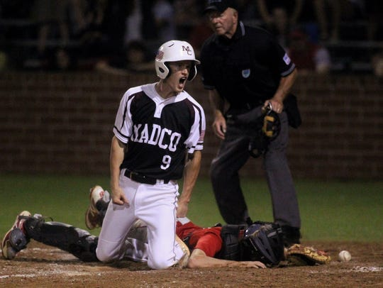 Madison County's Dylan Bass reacts to scoring the game-winning