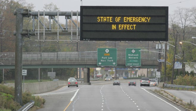A NJ DOT sign over the intersection of Route 4 and Route 208 inform the public of the State of Emergency due to Hurricane Sandy heading our way.
