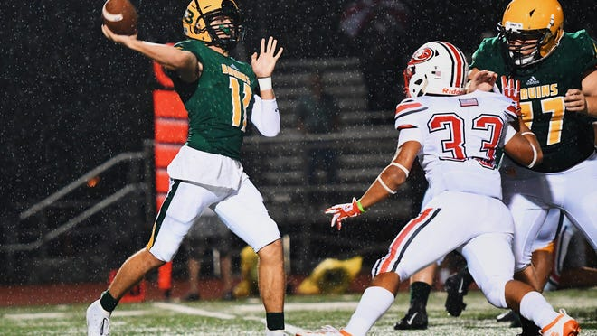 Rock Bridge quarterback Nathan Dent (11) throws the ball during a game against Jefferson City on Friday night at Rock Bridge High School.
