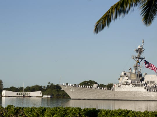 Destroyer Chung-Hoon passes by the USS Arizona Memorial on the 73rd anniversary of the attack Pearl Harbor that sank the battleship killing 1,177 sailors.