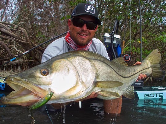 "Fishing guide and artist Capt. Stephen Ferrell of Melbourne Beach loves to fish for snook. ""There's nothing better. It's just intense."" Ferrell likes to fish from his paddleboard a lot and casts under docks, along mangrove shorelines and other structure to find snook, trout and redfish."